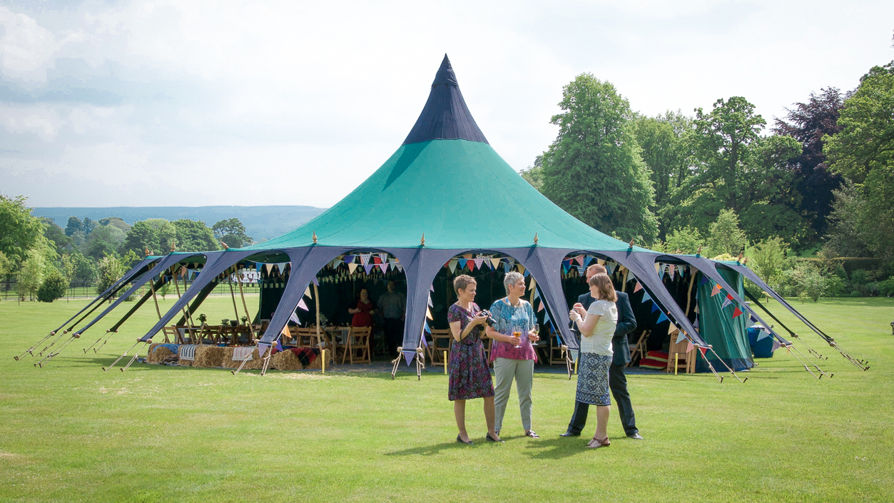 Giant Bell Tent wedding reception in the grounds of Chillingham Castle