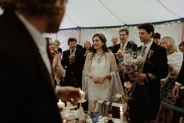 Bride and groom in Arched Wedding Tent