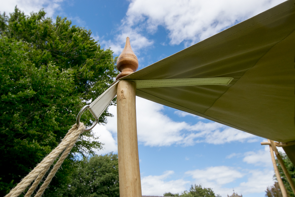 Wooden finial detail canvas awning